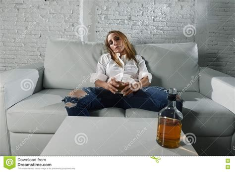 Sad Depressed Alcoholic Drunk Woman Drinking At Home In