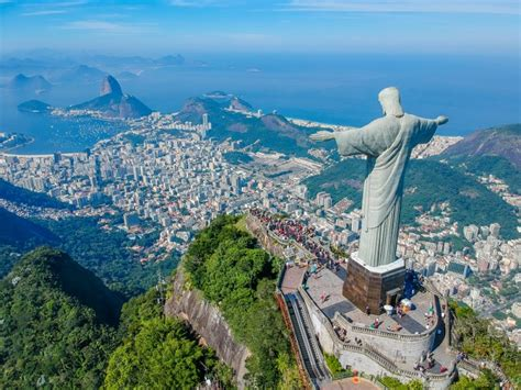 Brazil's Statue Of Jesus Lights Up With Flags Of Countries
