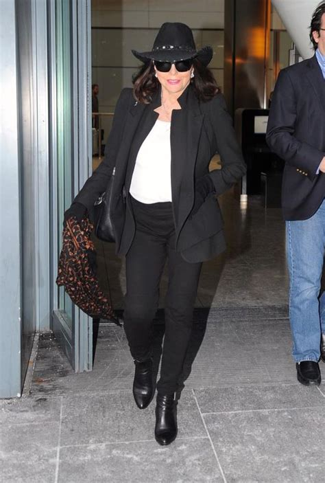 Joan Collins looks super chic in black and white as she